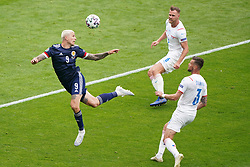 Scotland's Lyndon Dykes heads clear during the UEFA Euro 2020 Group D match at Hampden Park, Glasgow. Picture date: Monday June 14, 2021.