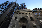 Juxtaposition of the Lloyds of London building with some older buildings in London's insurance area.