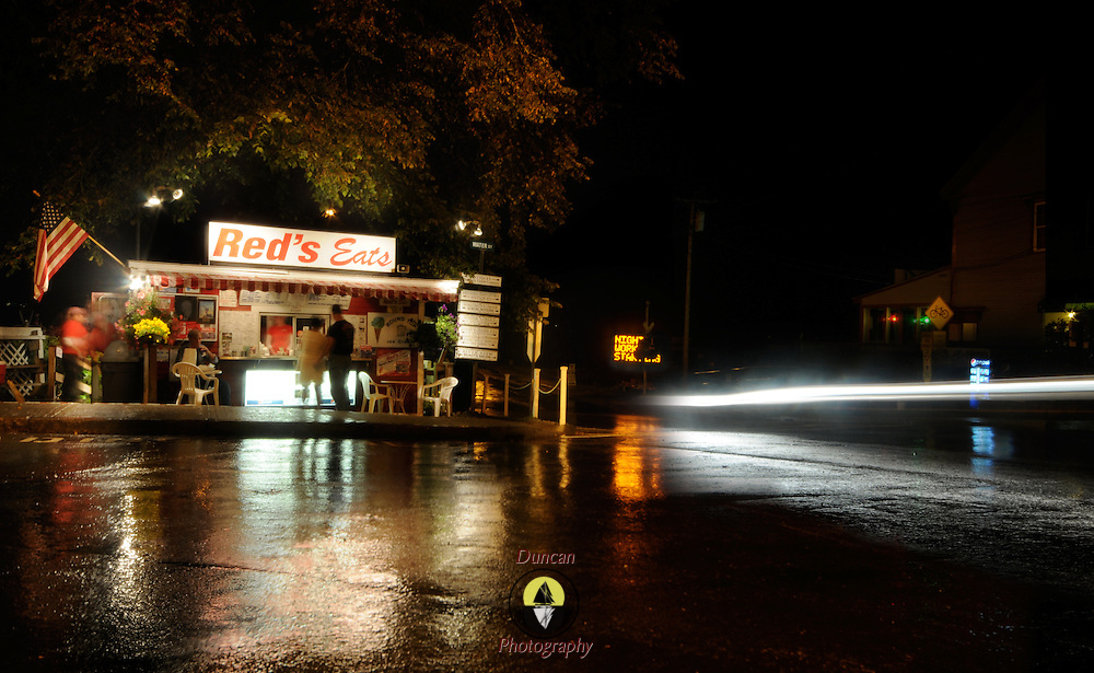 7/3/11 -- WISCASSET, Maine. Red's Eats, a Maine fixture at all times of day and night, draws folks even in the rain and the night . Composite Photo by Roger S. Duncan.
