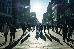 View of busy Buchanan Street on a sunny winter day in Glasgow, Scotland, United Kingdom