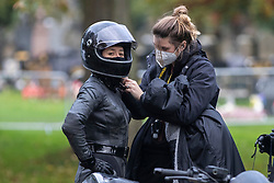 © Licensed to London News Pictures. 13/10/2020. Liverpool, UK. A Catwoman stunt double films a scene at Anfield Cemetery, Liverpool for The Batman film. Photo credit: Kerry Elsworth/LNP