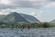 A group of stand up paddleboarders on Lake Grasmere on the 13th June 2019 in the Lake District in the United Kingdom. Lake Grasmere is also known River Rothay and is near the town of Grasmere in the Lake District in Cumbria.