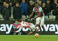 Football - 2016 / 2017 Premier League - West Ham United vs. Stoke City<br /> <br /> Cheikhou Kouyate of West Ham knocks Bojan Krkic of Stoke City off the ball at The London Stadium.<br /> <br /> COLORSPORT/DANIEL BEARHAM