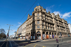 Edinburgh, Scotland, UK. 8 April 2020. Images from Edinburgh during the continuing Coronavirus lockdown. Pictured; Jenners department store on Princes Street and a normally busy pedestrian crossing which is now deserted. Iain Masterton/Alamy Live News.
