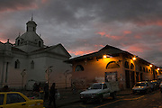 Sunset over the La Merced church and market in Latacunga, city founded in 1534 and located at 2,760 meters above sea level at the base of the Cotopaxi volcano. Latacunga , Cotopaxi, Ecuador. February 19, 2013.