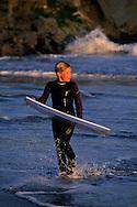 Reed Weseman with boogie board on beach along West Cliff Drive, Santa Cruz, CALIFORNIA