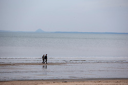 People on the beach at Portobello. Edinburgh on the day after the Lockdown.