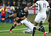 Malakai Fekitoa of the All Blacks is tackled by Tom Wood of England during the third rugby test between the All Blacks and England played at Waikato Stadium in Hamilton during the Steinlager Series - All Blacks v England, Hamiton, 21 June 2014<br /> www.photosport.co.nz