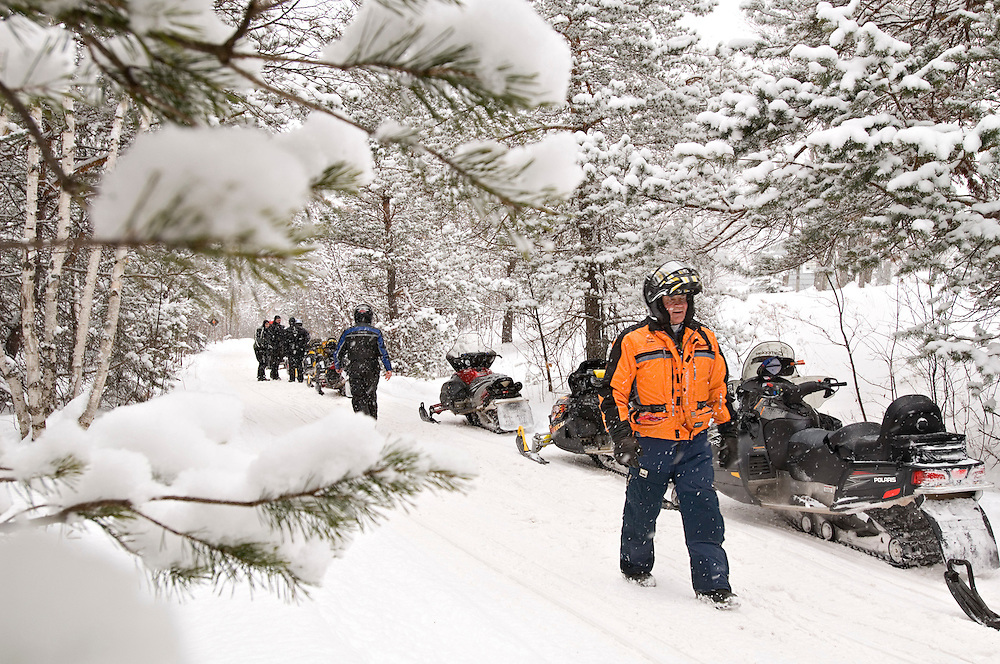 Richard Decker, owner of Snow-Venture Tours, speaks with clients along Trail 3 on the Keweenaw Peninsula during a break during a tour of Michigan's Upper Peninsula.