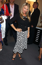 Singer LYNSEY DE PAUL at a private view of fashion designer Lindka Cierach's Couture Dresses drawn by Trudy Good held at the Belgravia Gallery, 45 Albemarle Street, London on 21st September 2005.<br />