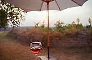Hot summer in Burgundy, sunset, a glass of cool rose wine, a sun umbrella