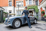 Commander Pat Douglas RN stands with the car after driving it to Dukes Hotel. An Aston Martin DB 2/4, which is understood to have been Ian Fleming's inspiration for James Bond's Aston Martin in the original novel Goldfinger. It was recently discovered and refurbished by owners  John and Daniel Walford.  It is to be auctioned on 12 July at Blenheim Palace  by international auctioneers Coys.Dukes Hotel, St James's Place,l London