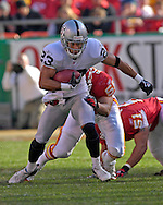 Oakland Raiders punt returner Chris Carr (23) takes off up field after a Kansas City punt at Arrowhead Stadium in Kansas City, Missouri, November 19, 2006.  The Chiefs beat the Raiders 17-13.<br />