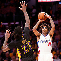 31 October 2014: Los Angeles Clippers guard Chris Douglas-Roberts (14) takes a jump shot Los Angeles Lakers forward Jordan Hill (27) during the Los Angeles Clippers 118-111 victory over the Los Angeles Lakers, at the Staples Center, Los Angeles, California, USA.