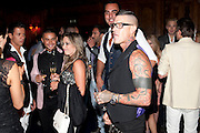 MARIA FERNANDA; TIM WHITMORE, ( TATTOOS, ) DSquared2 Launch of their Classic collection. Tramp. Jermyn St. London. 29 June 2011. <br /> <br />  , -DO NOT ARCHIVE-© Copyright Photograph by Dafydd Jones. 248 Clapham Rd. London SW9 0PZ. Tel 0207 820 0771. www.dafjones.com.