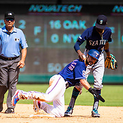 Aug 01 2019, Arlington, TX  U.S.A.  Seattle second baseman Dee Gordon (9) tags out Rangers relief pitcher Jonathan Hernandez (72) during the MLB game between the Seattle Mariners and the Texas Rangers 11-3 win at Globe Life Park in Arlington,TX. Thurman James / CSM