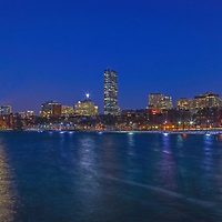 Sunday, 12 March 2017, I was on a mission to capture the moon rising across the Boston skyline. It was a frigid cold night and in the single digits. This was probably the main reason that there were not many people on the street, no bikers, walkers and runners and yes, I did not spot any other photographer that night. In this moon and skyline photography image, I selected a wide view of the Hub that includes the familiar Charles River skyline landmarks such as the John Hancock tower and Prudential Center in the Back Bay and the newly constructed Millennium Tower, one of Boston's latest landmarks and building architecture. <br /> <br /> Boston full moon photos are available as museum quality photo prints, canvas prints, acrylic prints or metal prints. Fine art prints may be framed and matted to the individual liking and decorating needs:<br /> <br /> http://juergen-roth.pixels.com/featured/boston-moon-rise-juergen-roth.html<br /> <br /> All Boston skyline photos are available for photography image licensing at www.RothGalleries.com. Please contact me direct with any questions or request.<br /> <br /> Good light and happy photo making!<br /> <br /> My best,<br /> <br /> Juergen<br /> Prints: http://www.rothgalleries.com<br /> Photo Blog: http://whereintheworldisjuergen.blogspot.com<br /> Instagram: https://www.instagram.com/rothgalleries<br /> Twitter: https://twitter.com/naturefineart<br /> Facebook: https://www.facebook.com/naturefineart