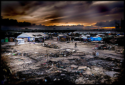 October 27, 2016 - Calais, Northern France, France - Image ©Licensed to i-Images Picture Agency. 27/10/2016. Calais, France. Calais Jungle Migrant Camp. Last few remaining refugees walk around what is left of the Calais Jungle migrant camp after bulldozers have torn it apart all day. As the French police close it down. Picture by Andrew Parsons / i-Images (Credit Image: © Andrew Parsons/i-Images via ZUMA Wire)