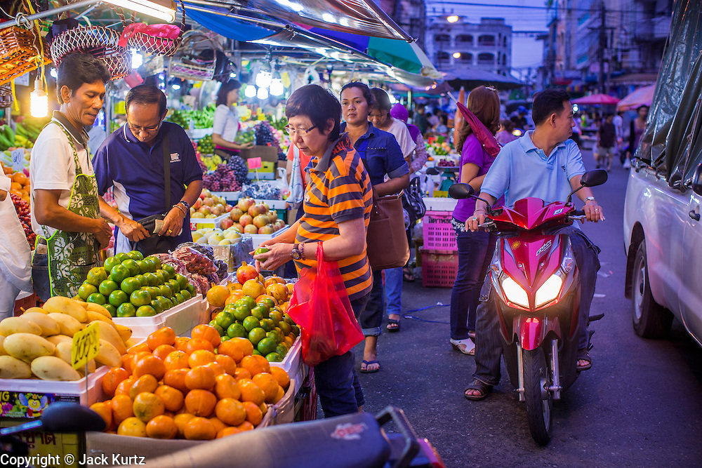 22 OCTOBER 2012 - HAT YAI, THAILAND:      A fruit vendor in the market in Hat Yai, Thailand. Hat Yai is the largest in southern Thailand. It is an important commercial center and tourist destination. It is especially popular with Malaysian, Singaporean and Chinese tourists.     PHOTO BY JACK KURTZ