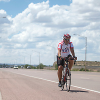 David Cook rides his bicycle along Route 66 on the West side of Gallup Wednesday.