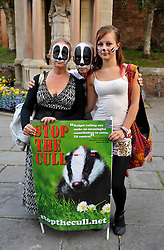 © Licensed to London News Pictures. 26/08/2013. Minehead, Somerset, UK.  Picture of Julie, Stephen and Amber. People protesting against the planned badger cull gather hold a candlelit vigil and march in the town of Minehead in West Somerset which is one of the areas where badgers will be shot by marksmen in a pilot trial with the eventual aim of reducing bovine turberculosis in cattle.  28 August 2013.<br /> Photo credit : Simon Chapman/LNP