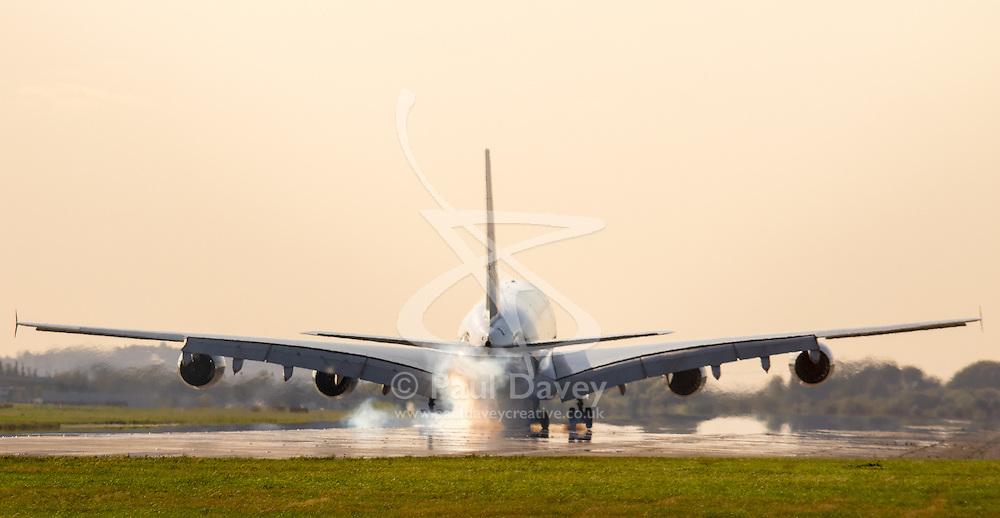 An Airbus A380 lands at London's Heathrow Airport (LHR / EGLL).