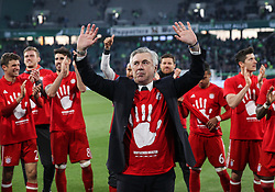 WOLFSBURG, April 30, 2017  Bayern's head coach Carlo Ancelotti(Front) and the players greet the spectators after the German Bundesliga match between VfL Wolfsburg and Bayern Munich in Wolfsburg, Germany, on April 29, 2017. Bayern Munich won 6-0 to clinch its fifth consecutive Bundeslisga title ahead of schedule at the 31st round on Saturday. (Credit Image: © Shan Yuqi/Xinhua via ZUMA Wire)