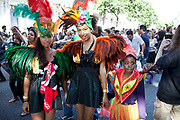 Costumed dancers at the Notting Hill Carnival in West London. The Notting Hill Carnival is an annual event which since 1964 has taken place each August, over two days (the August bank holiday Monday and the day beforehand). It is led by members of the West Indian / Caribbrean community, particularly the Trinidadian and Tobagonian British population, many of whom have lived in the area since the 1950s. The carnival has attracted up to 2 million people in the past, making it the second largest street festival in the world. The celebration centres around a parade of floats, dancers and sound systems.