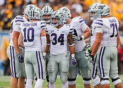 Sep 22, 2018; Morgantown, WV, USA; Kansas State Wildcats players listen to Kansas State Wildcats quarterback Skylar Thompson (10) before a play during the second quarter against the West Virginia Mountaineers at Mountaineer Field at Milan Puskar Stadium. Mandatory Credit: Ben Queen-USA TODAY Sports
