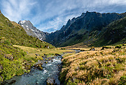 Mount Awful (2192 m / 7190 ft, left) at the headwaters of the Young River, on the Gillespie Pass Track, in Mount Aspiring National Park, Southern Alps, Otago region, South Island of New Zealand. UNESCO lists Mount Aspiring as part of Wahipounamu - South West New Zealand World Heritage Area. This image was stitched from multiple overlapping photos.