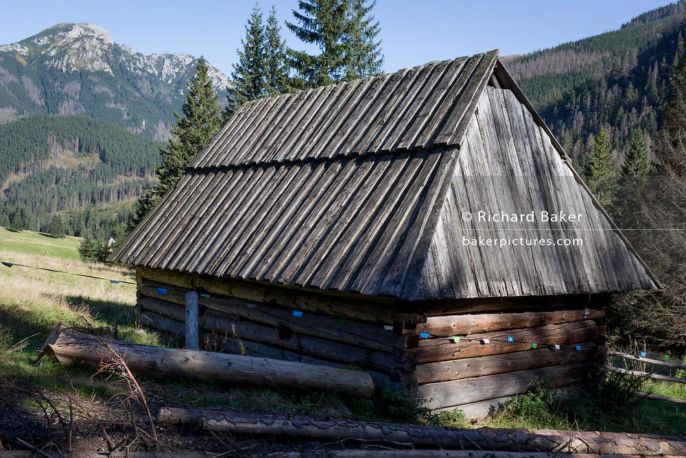 An traditional wooden agricultural hut on Polana Chocholowska a hiking route on Dolina Chocholowska in the Tatra National Park, on 17th September 2019, near Zakopane, Malopolska, Poland.