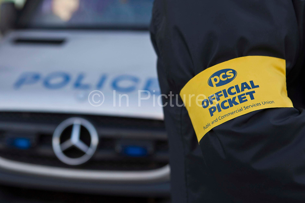 The armband of one of the official picketers at the Public and Commercial Services Union strike outside Lewisham Police station, south east London, United Kingdom. On March 8, 2010, 270,000 civil servants began a national 48 hour strike, over government changes to redundancy payments