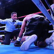 Yenifel Vicente knocks out Victor Proa during their championship boxing match for the WBO Latin American junior featherweight title at the Hotel El Panama Convention Center on Wednesday, October 31, 2018 in Panama City, Panama. (Alex Menendez via AP)