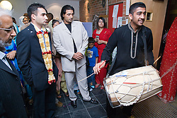 Dholki drum being beaten to signal arrival of groom at his wedding,