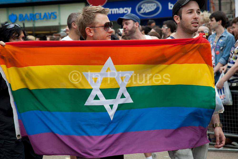 Star of David on a rainbow flag. Pride London gay and lesbian parade through central London. Pride London (founded in 2004) aims to promote equality and diversity through all of its campaigns. The Pride London festival uses theatre, music, debate, art and entertainment to raise awareness of discrimination and the issues and difficulties affecting the lives of lesbian gay bisexual and transgender people around the world. The annual parade is an explosion of Pride in the heart of the capital, attracting over 1,000,000 people in a celebration of diversity.