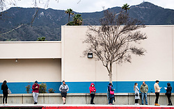 March 16, 2020, Glendale, California, USA: People appear to take precaution from the coronavirus as they stand apart while inline at the DMV in Glendale on Monday. (Credit Image: © Sarah Reingewirtz/Orange County Register via ZUMA Wire)