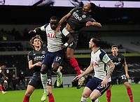Football - 2020 / 2021 EFL Carabao League Cup - Semi-Final - Tottenham Hotspur vs Brentford - Tottenham Hotspur Stadium<br /> <br /> Pinnock of Brentford jumps with Moussa Sissoko of Spurs<br /> <br /> COLORSPORT/ANDREW COWIE