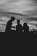 Stuttgart, Germany - August 11, 2018: Silhouettes at sunset at the Birkenkopf, a 511-meter high hill in Stuttgart, Germany. Much of Stuttgart was destroyed by Allied bombing during WWII, and in the 1950s rubble was carried to the top of this hill, increasing its height by around 40 meters.