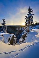 Sun dog around the setting sun over McIntyre Creek, Yukon