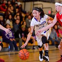 021314       Cable Hoover<br /> <br /> Miyamura Patriot Raquel Spencer (22) pushes through the Valencia Jaguars defense Thursday at Miyamura High School.