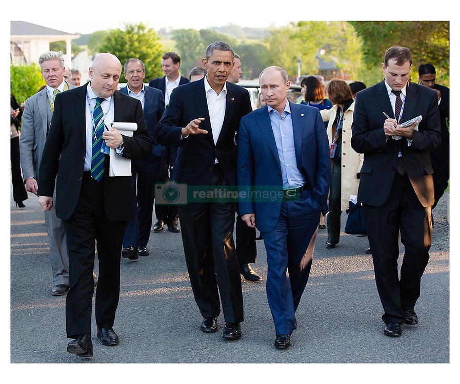 """Pete Souza releases a photo on Instagram with the following caption: """"Unlike Comrade minus, President Obama was never the subject of an FBI inquiry as to whether he was secretly working for Russia. I might add that when he was talking or meeting with Vladimir Putin, there were others listening nearby. \ud83d\ude0e #throwshadethenvote"""". Photo Credit: Instagram *** No USA Distribution *** For Editorial Use Only *** Not to be Published in Books or Photo Books ***  Please note: Fees charged by the agency are for the agency's services only, and do not, nor are they intended to, convey to the user any ownership of Copyright or License in the material. The agency does not claim any ownership including but not limited to Copyright or License in the attached material. By publishing this material you expressly agree to indemnify and to hold the agency and its directors, shareholders and employees harmless from any loss, claims, damages, demands, expenses (including legal fees), or any causes of action or allegation against the agency arising out of or connected in any way with publication of the material."""