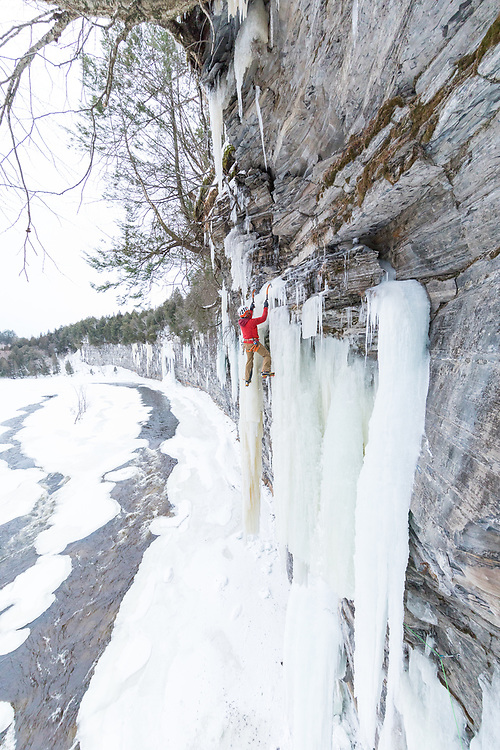 Jeff Mercier climbing a first ascent called Snowstorm, M9 WI6 in Pont-Rouge Quebec, Canada