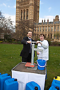 Steve Webb MP and a constituant. Marking World Water Day, over 40 MP's walked for water at Westminster, London at an event organised by WaterAid and Tearfund. Globally hundreds of thousands of people took part in the campaign to raise awareness of the world water crisis.