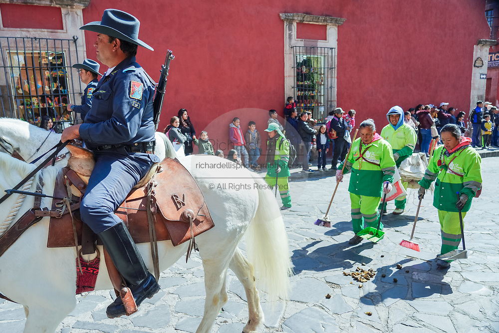 Mexican mounted police ride their horses in a parade to celebrate the 251st birthday of the Mexican Independence hero Ignacio Allende as a clean up crew follows behind January 21, 2020 in San Miguel de Allende, Guanajuato, Mexico. Allende, from a wealthy family in San Miguel played a major role in the independency war against Spain in 1810 and later honored by his home city by adding his name.