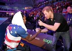 Prince Harry congratulates the US team at the wheelchair basketball at the Mattamy Athletic Centre at the 2017 Invictus Games in Toronto, Canada.