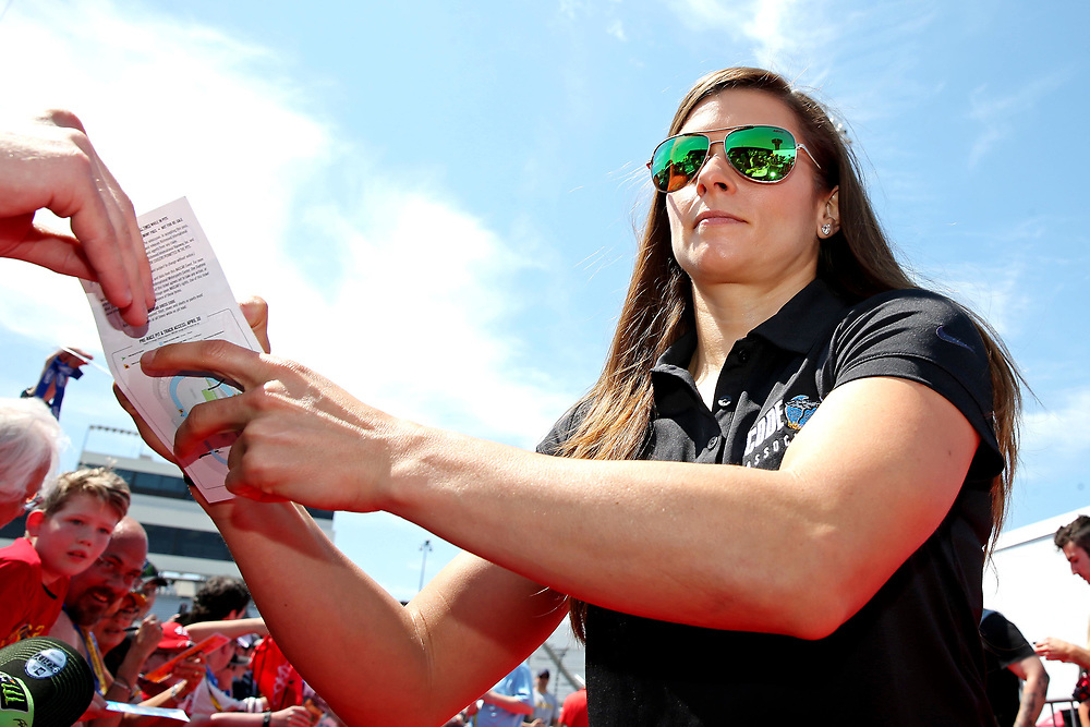 Apr 30, 2017; Richmond, VA, USA; NASCAR Cup Series driver Danica Patrick (10) signs autographs before the Toyota Owners 400 at Richmond International Raceway. Mandatory Credit: Peter Casey-USA TODAY Sports