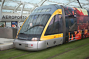 Metro train on grass tracks Oporto airport station, Porto, Portugal Aeroporto Francisco sa Carnero