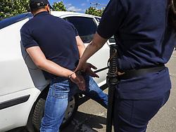 May 16, 2015 - female police officer arrests a criminal (Credit Image: © Igor Golovniov/ZUMA Wire/ZUMAPRESS.com)