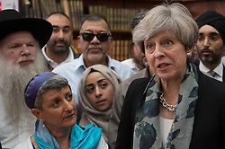 Prime Minister Theresa May talk to faith leaders at Finsbury Park Mosque in north London, near where one man has died, eight people taken to hospital and a person arrested after a rental van struck pedestrians.