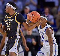 Southern Miss Golden Eagles forward Leonard Harper-Baker (32) looks to pass as Middle Tennessee Blue Raiders guard Eli Lawrence (5) attempts to steal the ball during the Southern Mississippi Golden Eagles at Middle Tennessee Blue Raiders college basketball game in Murfreesboro, Tennessee, Saturday, March, 7, 2020.<br /> Photo: Harrison McClary/All Tenn Sports